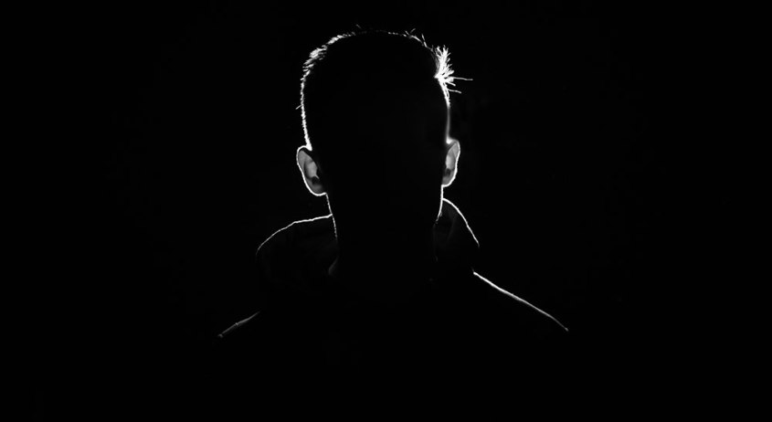 A man portrait in the dark with Silhouette