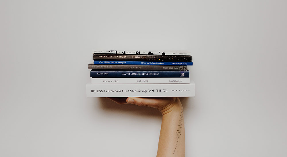 Hand holding books