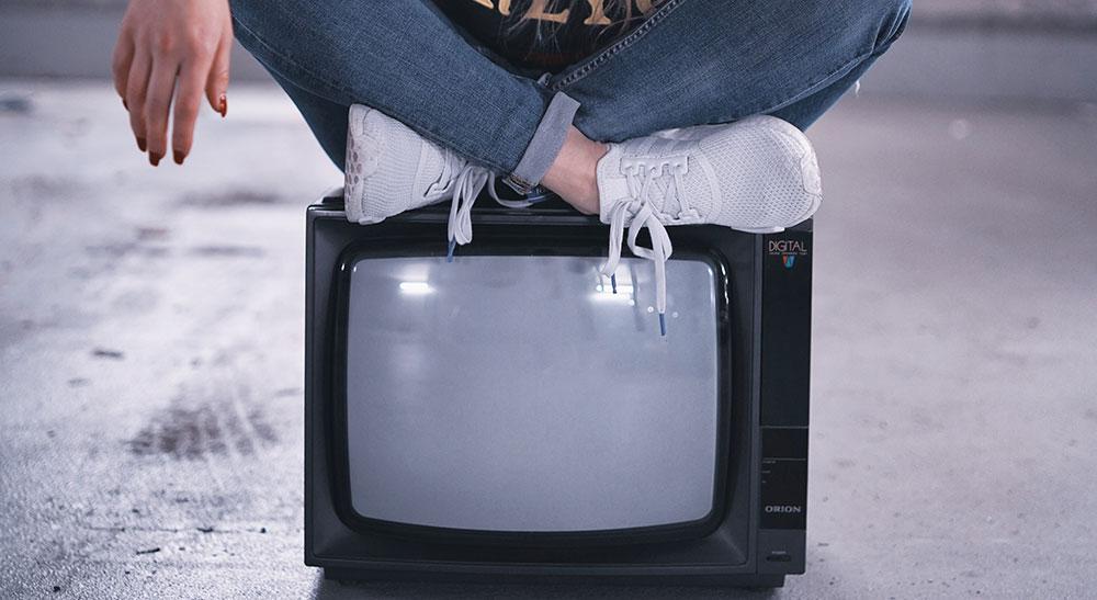girl sit on tv